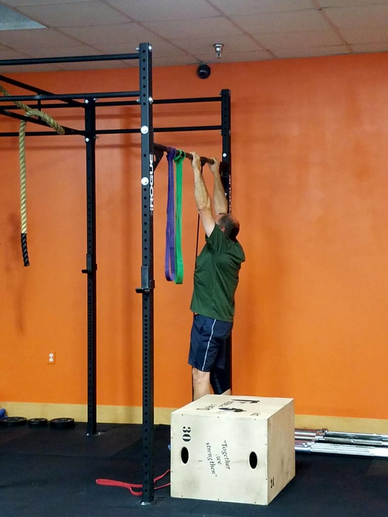 Moe hitting his first pull-up reps on the black band.